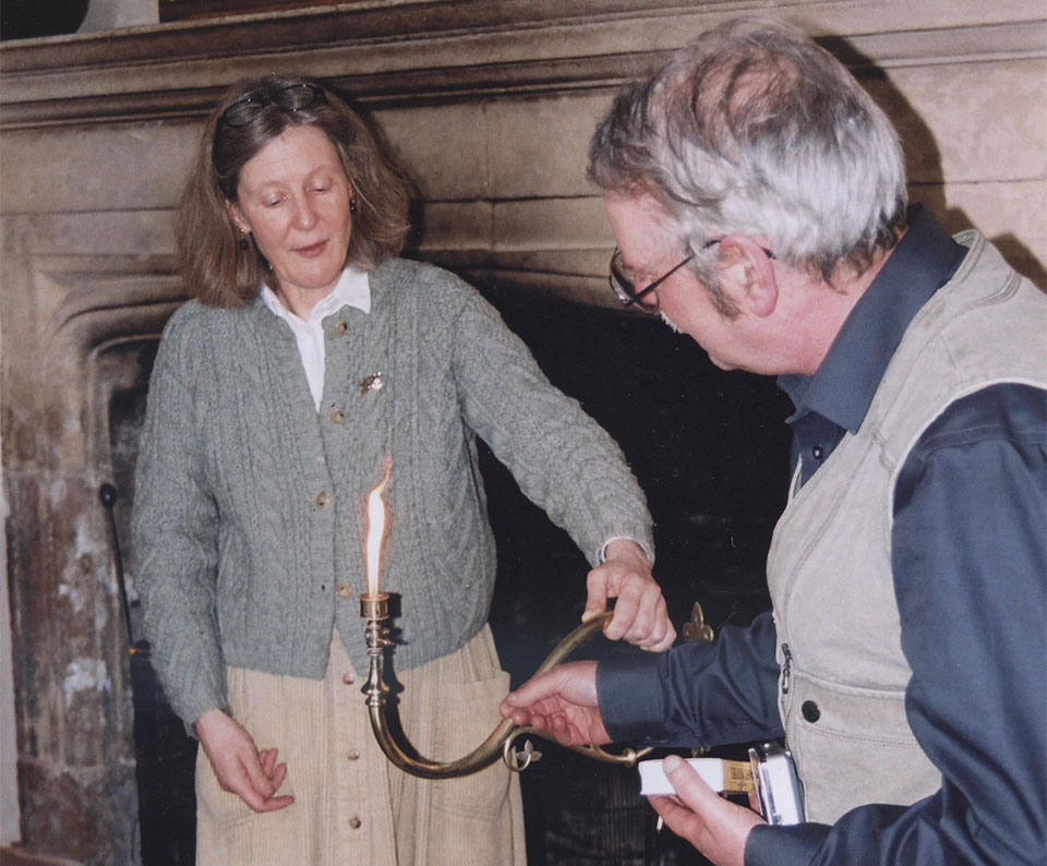Geoff Wallace lights a restored Hardman gas lamp with Julia Elton at Clevedon Court