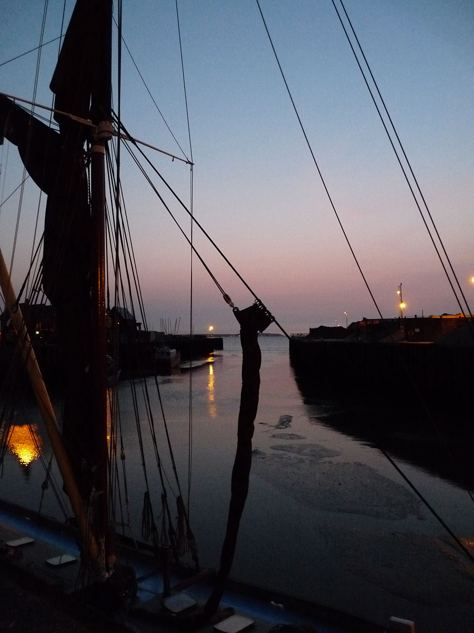 Whitstable Harbour: Sunset on a coastal sailing vessel - © Jonathan Aylen