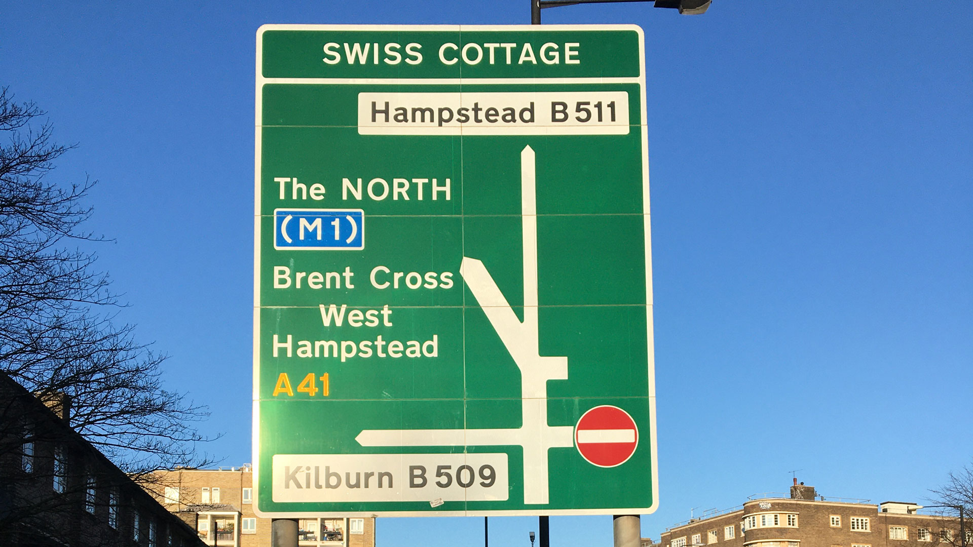 Swizz Cottage Road Sign show A Roads, B Roads & Motorway