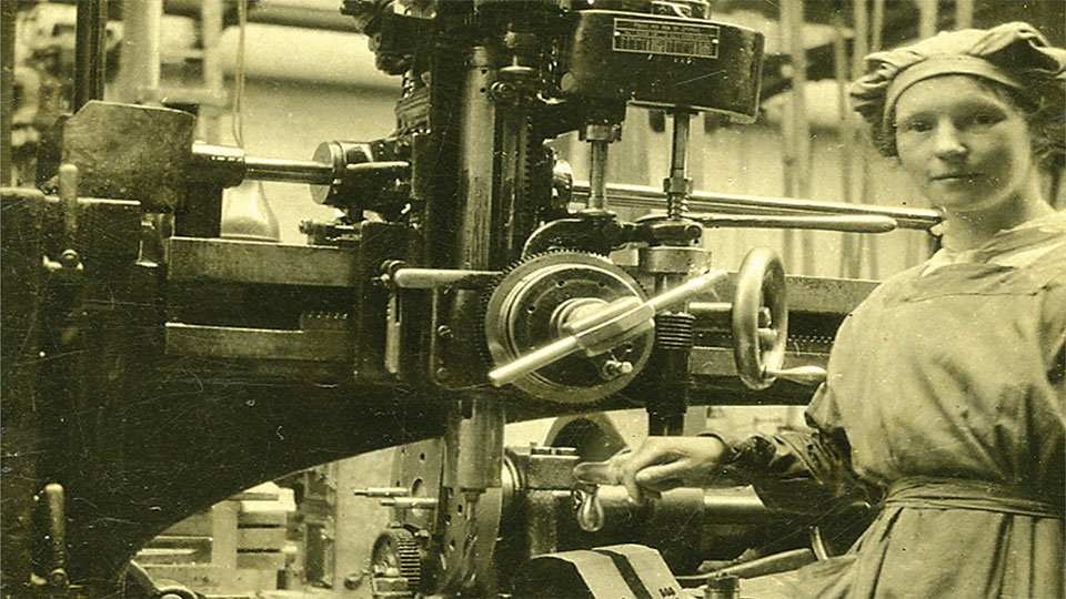Woman engineer drilling an aero engine crankshaft at the Tongland Works in Galloway during the first decades of the 20th Century (Stewartry Museum, Kirkcudbright)